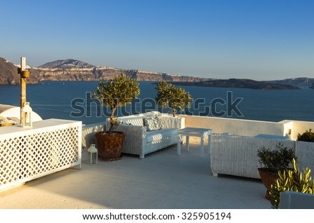 A tranquil terrace under the setting sun in the beautiful greek island