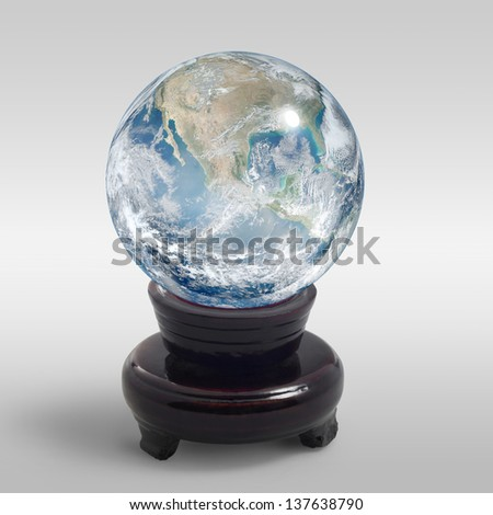 a translucent crystal globe on stand in light grey back - stock photo