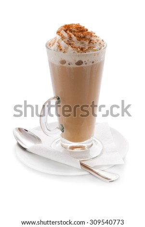 A transparent glass cup of hot coffee with cream and cinnamon on a white background, forforovoe saucer, napkin, spoon