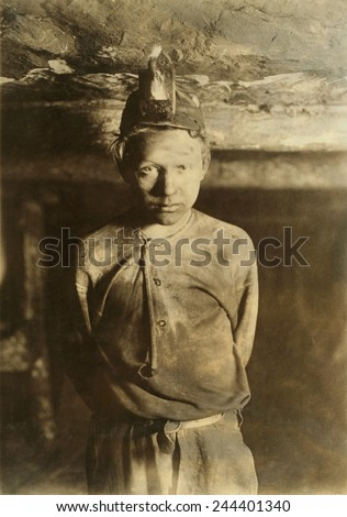 A Trapper Boy, whose job was to wait in the dark mine, opening and closing a door connecting one mine chamber to another. Turkey Knob Mine, Macdonald, West Virginia. October 1908 photo by Lewis Hine. - stock photo