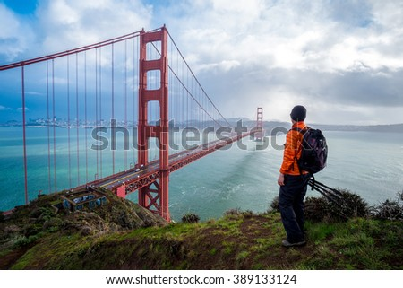 A traveler is looking at the Golden Gate Bridge, San Francisco, USA