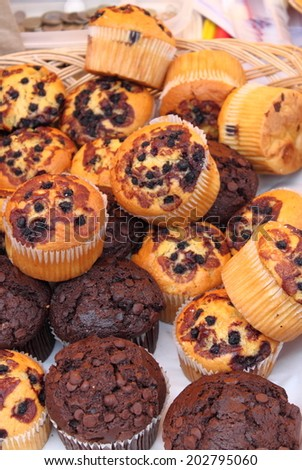 A tray full of fresh muffins sold in a patisserie - stock photo