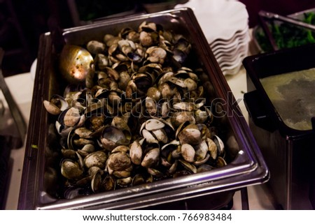 A tray full with mussels ready for service, in a traditional Chinese restaurant.
