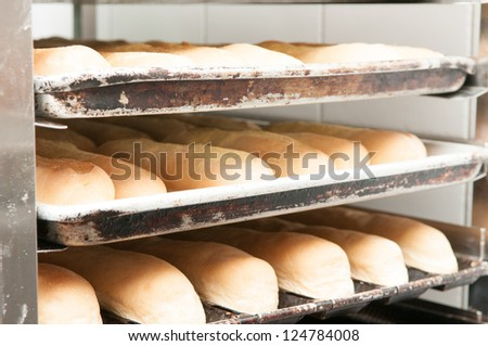 a tray of fresh baguettes - stock photo