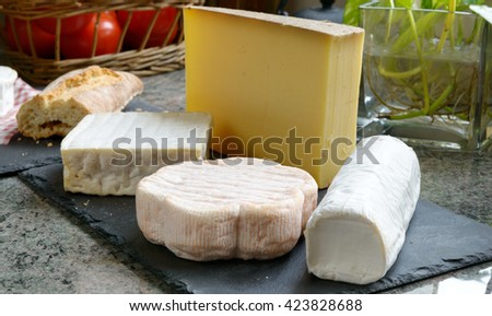 a tray with different French cheeses