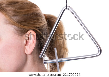 A triangle in the vicinity of a female ear - stock photo