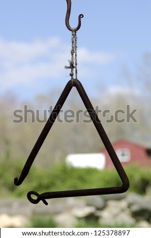 A triangle used as a dinner bell at a Connecticut farmhouse