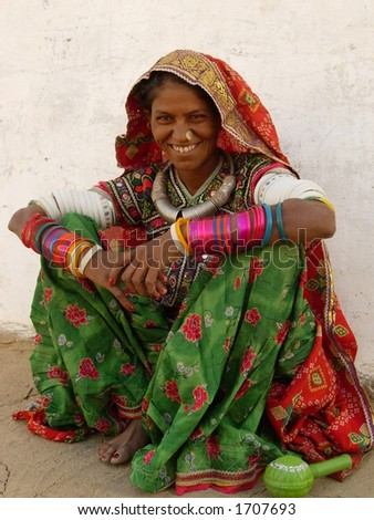 a tribal women posing in a village in india - stock photo