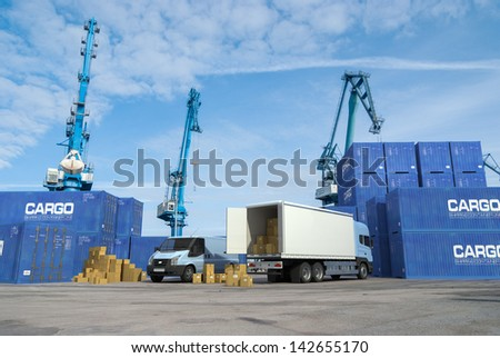 A truck unloading in the middle of a commercial dock - stock photo