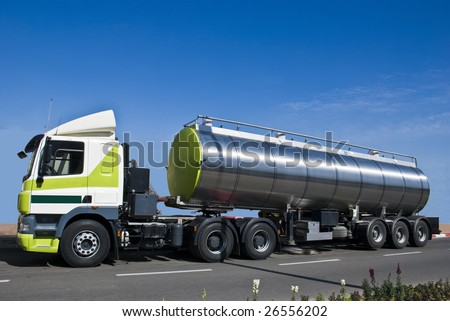 A truck with a big tank for delivering liquid cargoes.