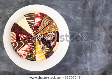 A try of fourteen different types of cheese cake on a platter from above. - stock photo