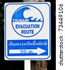 A tsunami warning sign located near a beach in Phuket, Thailand - stock photo