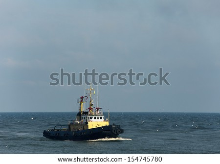 A tug boat at Baltic sea  - stock photo