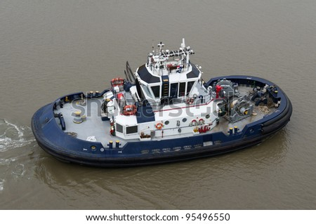 A tug boat working on the Panama Canal - stock photo