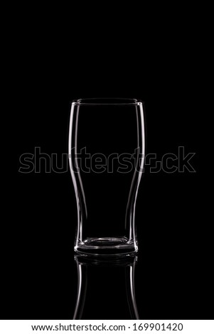 A Tulip Shaped Pint Glass on a Black Background - stock photo