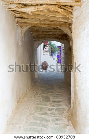 A tunnel-like alley, passing under a house, in the old section of Chora town, Folegandros island