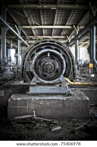 A turbine at an abandoned power station. - stock photo