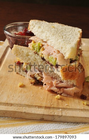 a turkey sandwich on homemade bread with cranberry sauce