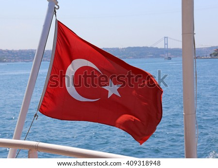 A Turkish flag flying off the back of a ferry in Istanbul, Turkey.  - stock photo