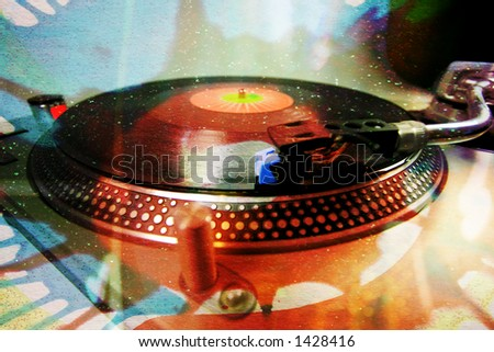 a turntable with an abstract glittery pattern overlayed - stock photo