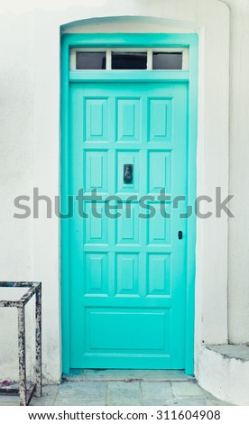 A turquoise front door in a greek house - stock photo