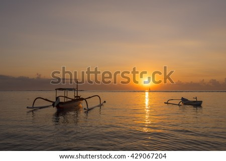 A twin Jukung Boat during a beautiful morning at Sanur beach, Bali Indonesia - stock photo