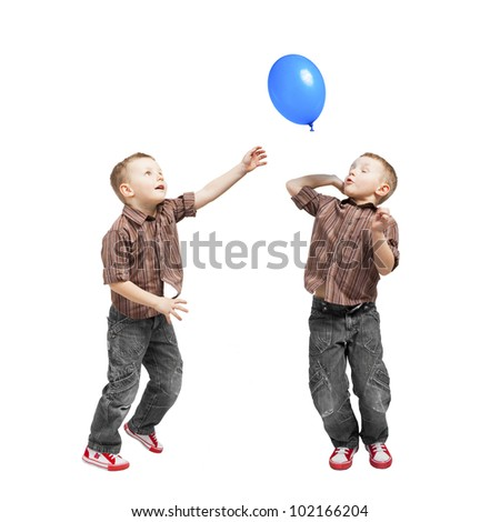A twins conquering the balloon. They jump, they are very busy. - stock photo