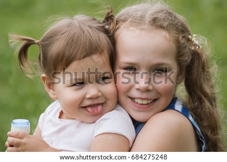A two banies sisters playing in park, outdoor walking