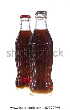 a two  bottles of cola soda isolated on a white background - stock photo