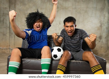 A two people friend Cheering for the soccer football happy - stock photo