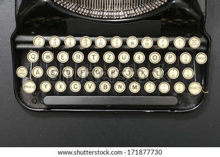 a typewriter in dramatic lighting. - stock photo