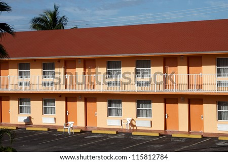 A Typical American Motel with the odd plastic seat outside - stock photo