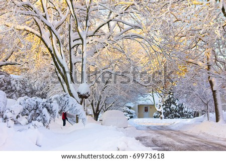 A typical American street sunlit in morning light after a heavy snowfall - stock photo