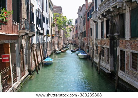 a typical corner of Venice Italy: ancient buildings, gondola and other particular architectures - stock photo