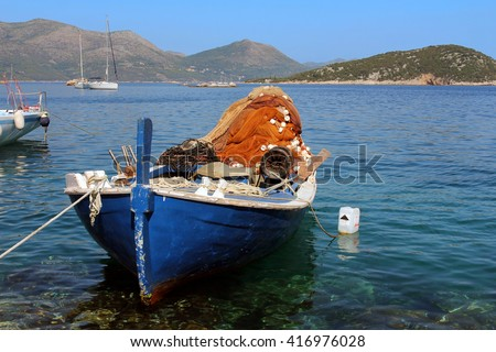 A typical fishing boat anchored on Sipan Island, the largest of the Elaphiti Islands, near Dubrovnik in the Dalmatian region of Croatia. - stock photo