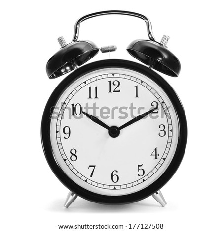 a typical mechanical alarm clock on a white background - stock photo