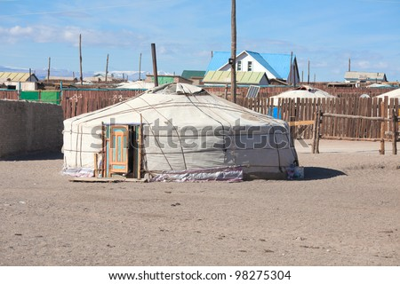 A typical Mongolian city. Small houses and traditional yurts for the fences - stock photo