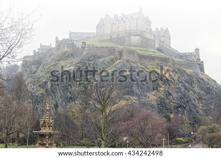 A typical rainy day in Edinburgh with the castle covered in mist in the background. - stock photo