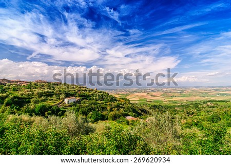 A typical scene in the rolling hills of the Tuscan landscape. - stock photo