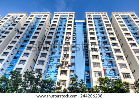 A typical Singapore highrise public housing estate against a blue sky. - stock photo