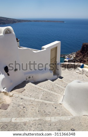 A typical stairway situated in the village of Oia on the greek island of Santorini - stock photo