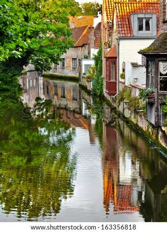 A typical street of the medieval Bruges. The medieval landscape. - stock photo
