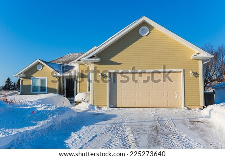 A typical suburban home in north america during the winter. - stock photo