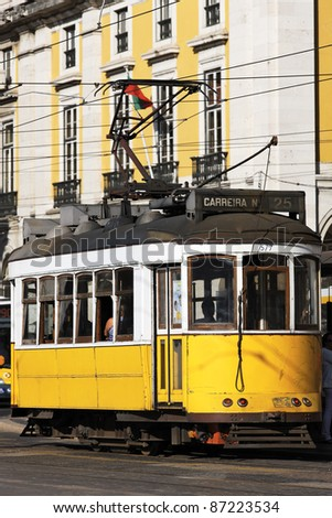 a Typical Tram in old street, Lisbon, Portugal - stock photo