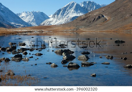 A typical U-shaped Valley in the mountains - stock photo