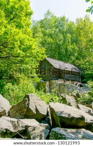 A typical ukrainian antique stone house in the forest, in Pirogovo near Kiev