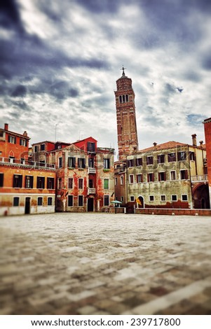 A typical  Venetian square Campo S.Anzolo, Venice, Italy. Filtered image - stock photo