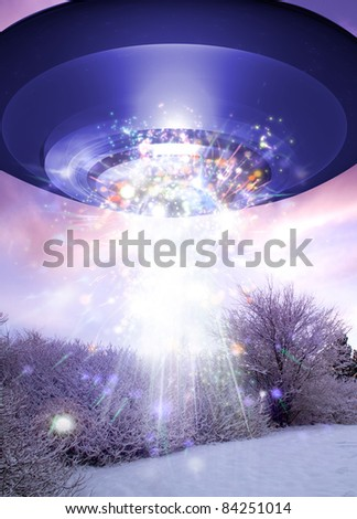 A UFO is seen over a snow covered scene with colored lights and smoke coming from below it.
