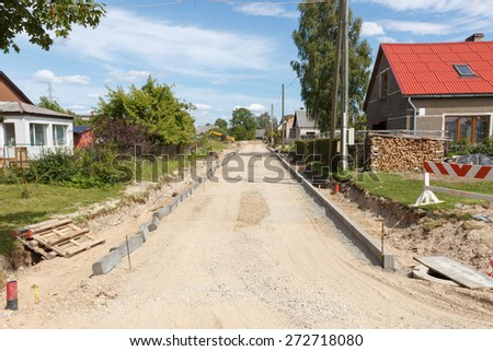 a unfinished road construction site with sand  - stock photo