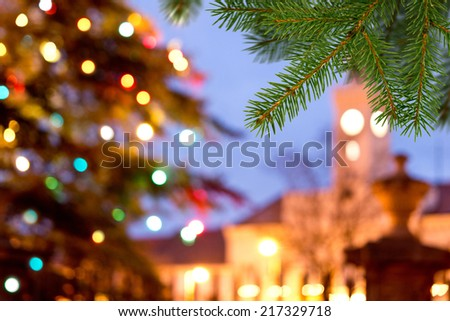 a unfocused christmas background with colored lights - stock photo